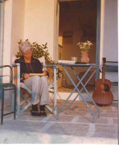 Greece Betty our porch on Paros with guitar