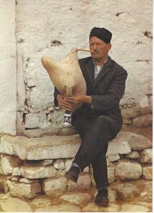 Greece Man playing goatskin bagpipe