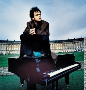 Jamie Cullum sitting on piano
